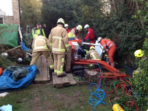 man trapped under digger