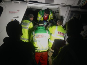 Loading of the casualty into the Surrey and Sussex Air Ambulance