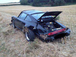 Porsche in field